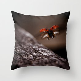 Ladybird in flight Throw Pillow