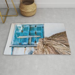 Distressed Blue Wooden Shutters and Beach Umbrella in Crete. Rug