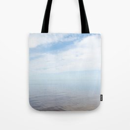 flying into the blue Tote Bag