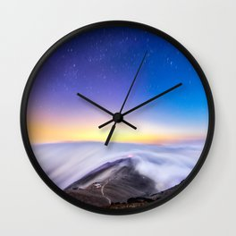 sea of clouds under starry night sky Wall Clock