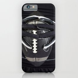 Black gloved hands holding a black American Football iPhone Case