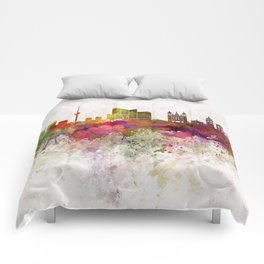Vilnius skyline in watercolor background Comforters