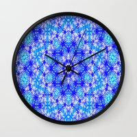 snowflake Wall Clocks featuring Snowflake by Kimberly McGuiness
