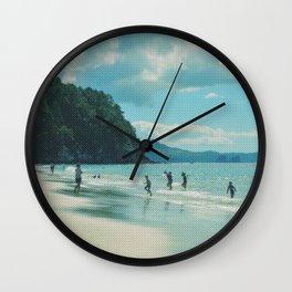 Playtime at the beach of Coromandel peninsula Wall Clock