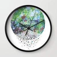 hakuna Wall Clocks featuring Hakuna Matata by Maria Sh