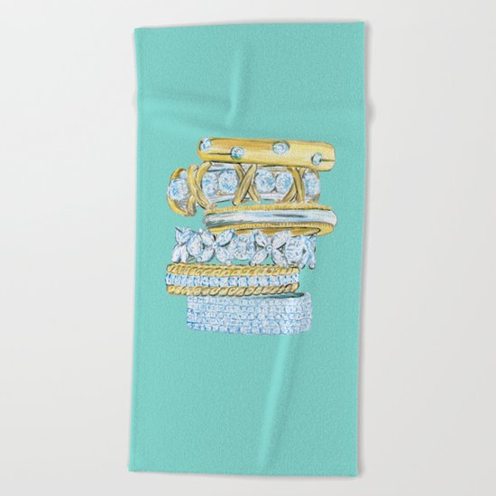Golden Rings on Blue Beach Towel