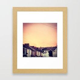Over the rooftops Framed Art Print