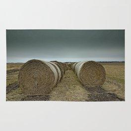 Hay bales on a field Rug
