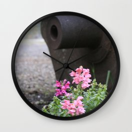 Flowers grow next to old mining equipment Wall Clock