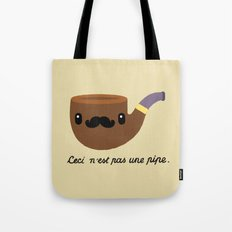 This is not a pipe. Tote Bag
