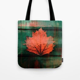 Rusty red dried fall leaf on wooden hunter green beams Tote Bag