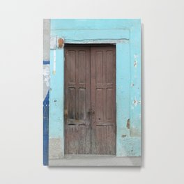 Brown Door in  a Blue Wall Metal Print