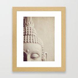 Cropped Buddha head statue. Framed Art Print