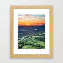 Beautiful sunset behind green fields Framed Art Print