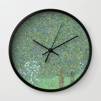 gustav klimt Wall Clocks featuring Gustav Klimt - Rosebushes under the Trees by TilenHrovatic