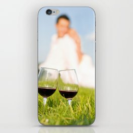 Two wineglasses with red wine in grass iPhone Skin