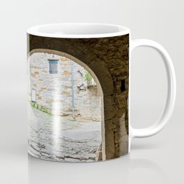 Dark passageway with arch to the light with old paving stone Coffee Mug