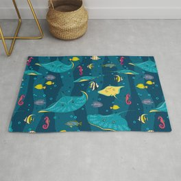 Decorative seamless pattern with sea fish on blue background. Rug