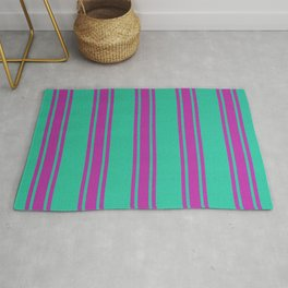 Pink lines on a turquoise background Rug