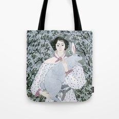 Girl and rabbit among flowers Tote Bag