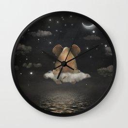 Sad elephant sitting on cloud in  night sky  Wall Clock