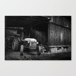 Tractor in barn Canvas Print