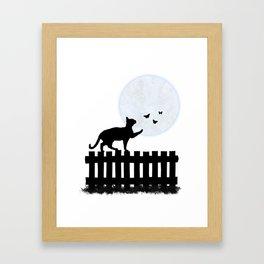 Playful Cat on a Fence Framed Art Print