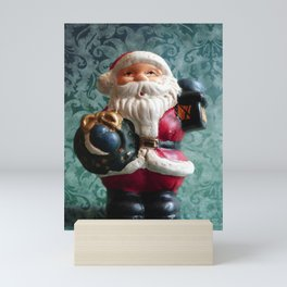 Small Santa Claus figure Mini Art Print