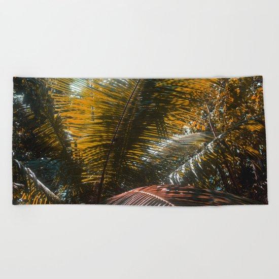 Into the Seychellian leaves Beach Towel