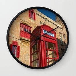 Red telephone cabin in the old town of Vialleta Wall Clock