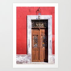 Ornate Wooden Door And A Rustic Red Wall In Mexico Art Print