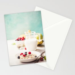 Oatmeal porridge with fresh berries, fruits and almond milk. Stationery Cards