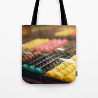 macarons Tote Bags featuring Macarons by Laura L.