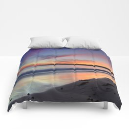 """Bolonia beach at sunset"" Comforters"