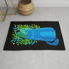 Cat and foliage - blue, green and black background Rug