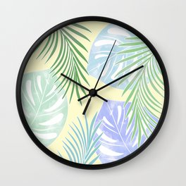 Tropical leaves pastel colors. Wall Clock