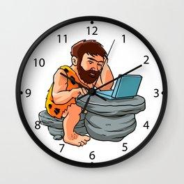 Cartoon caveman using a laptop. Wall Clock