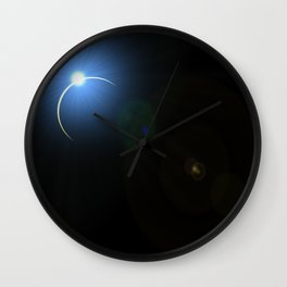 blue eclipse lens flare on black background Wall Clock