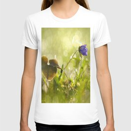 Beautiful spring - first flower little anemone with beautiful bokeh in green background T-shirt