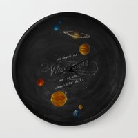 carl sagan Wall Clocks featuring Wanderers - Carl Sagan by Casey Ligon