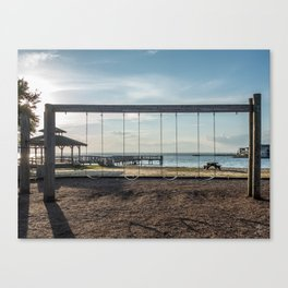 Swing Set Backlit by the Setting Sun Canvas Print