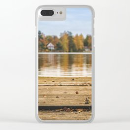 Pictuer of old slippers on the wooden pier with beautiful autumn background. Clear iPhone Case
