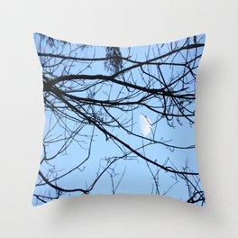 The moon through some branches Throw Pillow
