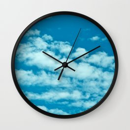 Beautiful blue sky and fluffy clouds Wall Clock