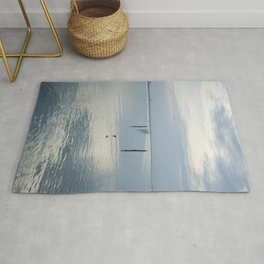 A blue lagoon and the water reflections Rug