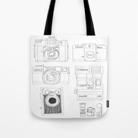 cameras Tote Bags featuring cameras by steffaloo