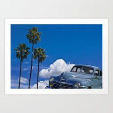 Vintage Blue Plymouth Automobile against Palm Trees and Cloudy Blue Sky Art Print