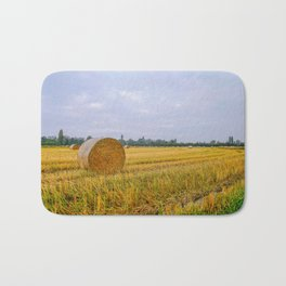 Hay bales in the Lomellina countryside during autumn Bath Mat