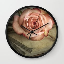 Pale pink on pile of old letters Wall Clock