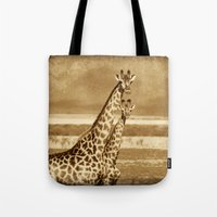 giraffes Tote Bags featuring Giraffes by haroulita